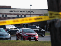 Crime scene tape is stretched across the front of Santa Fe High School on May 19, 2018 in Santa Fe, Texas. Yesterday morning, 17-year-old student Dimitrios Pagourtzis entered the school with a shotgun and a pistol and opened fire, killing at least 10 people. (Photo by Scott Olson/Getty Images)