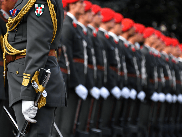 Soldiers of the Austrian guard of honor wait for Russian President Vladimir Putin before a wreath laying cermony at the Soviet World War II memorial in Vienna, Austria, June 5, 2018. President Putin is on a one-day state visit to Austria. (Photo by JOE KLAMAR / AFP) (Photo credit should …