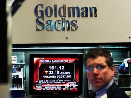 NEW YORK - APRIL 16: A financial professional works in the Goldman Sachs booth on the floor of the New York Stock Exchange while a television reports airs about the company's lowered stock price April 16, 2010 in New York, New York. Goldman Sachs was charged with fraud by the …
