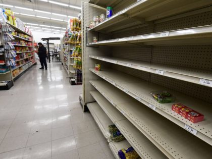 Grocery store shelf empty (Frederic J. Brown / AFP / Getty)