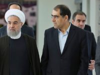 n this photo released by official website of the Iranian Presidency office, President Hassan Rouhani, center, listens to head of Iran's Atomic Energy Organization Ali Akbar Salehi, left, while attending a ceremony marking the national day of nuclear technology in Tehran, Iran, Thursday, April 7, 2016. Rouhani warned on Thursday …