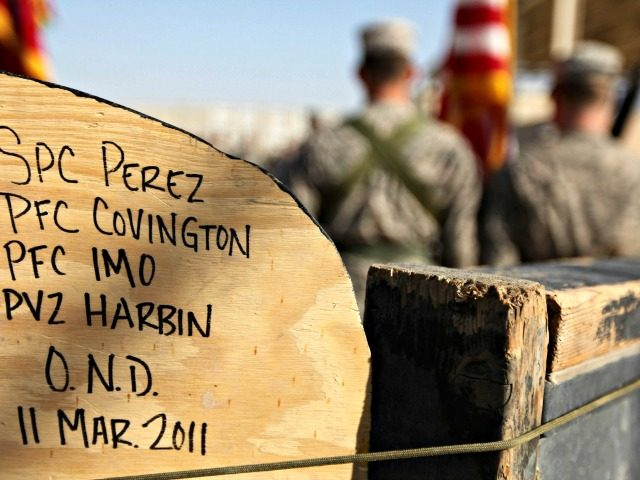 In this Dec. 17, 2011 photo, soldiers from the 3rd Brigade, 1st Cavalry Division, attend a casing of the colors ceremony by handwritten names of soldiers at Camp Adder, now known as Imam Ali Base, near Nasiriyah, Iraq. Around 500 troops from the 3rd Brigade, 1st Cavalry Division ended their …