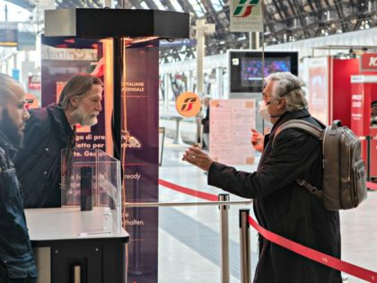 "MILAN, ITALY - MARCH 08: An elderly man, wearing a face mask, shows his ticket to a steward as he goes through security control at Milan's Central Station on March 08, 2020 in Milan, Italy. Prime Minister Giuseppe Conte announced overnight a ""national emergency"" due to the coronavirus outbreak and …"