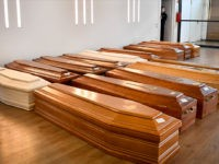 Coffins are lined up on the floor in the Crematorium Temple of Piacenza, Northern Italy, saturated with corpses awaiting cremation due to the coronavirus emergency Monday, March 23, 2020. For most people, the new coronavirus causes only mild or moderate symptoms. For some it can cause more severe illness, especially …