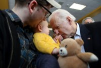 DUBUQUE, IOWA - FEBRUARY 02: Democratic presidential candidate former Vice President Joe Biden (R) greets a baby during a campaign event on February 02, 2020 in Dubuque, Iowa. With one day to go before the 2020 Iowa Presidential caucuses, Joe Biden is campaigning across Iowa. (Photo by Justin Sullivan/Getty Images)