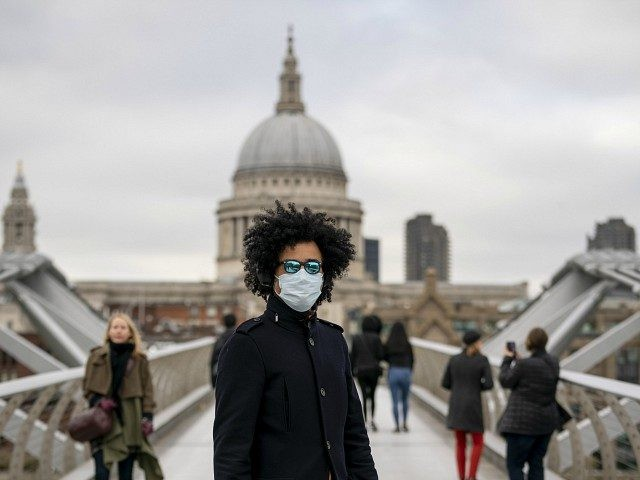 "Members of the public wear surgical masks to protect themselves from coronavirus on March 17, 2020 in London, England. The Prime Minister announced the UK is entering the ""delay"" phase of emergency planning for the Covid-19 crisis. Schools will not be closed at this time although they have been asked …"
