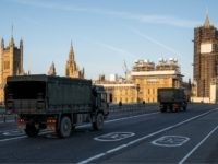 LONDON, UNITED KINGDOM - MARCH 24: Military vehicles cross Westminster Bridge after members of the 101 Logistic Brigade delivered a consignment of medical masks to St Thomas' hospital on March 24, 2020 in London, England. British Prime Minister, Boris Johnson, announced strict lockdown measures urging people to stay at home …