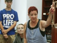 Norma McCorvey, right, the plaintiff in the landmark lawsuit Roe v. Wade, gestures as she speaks up as she joins other anti-abortion demonstrators inside House Speaker Nancy Pelosi's office on Capitol Hill in Washington, Tuesday, July 28, 2009. (AP Photo/Manuel Balce Ceneta)