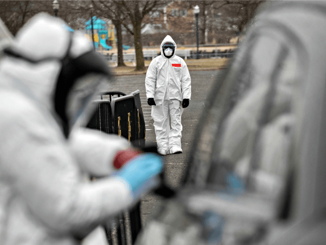 STAMFORD, CT - MARCH 23: Medical personnel dressed in personal protective equipment (PPE) prepare to give a coronavirus swab test at a drive-thru testing station at Cummings Park on March 23, 2020 in Stamford, Connecticut. Availability of protective clothing for medical workers has become a major issue as COVID-19 cases …