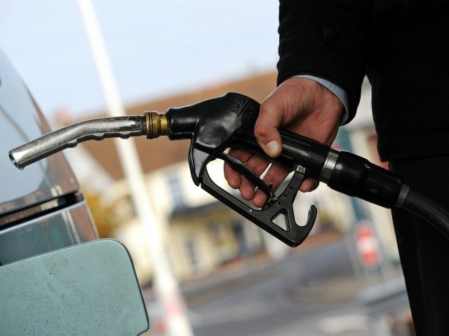 A customer pulls the nozzle of a petrol pump from their car at a petrol station in Egham, west of London on January 2, 2011. Motorists are having to pay record prices at the pumps after a Government fuel duty was added ahead of the VAT rise which will again …