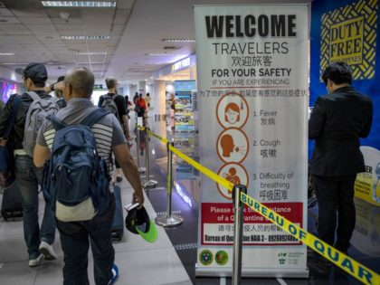 MANILA, PHILIPPINES - MARCH 10: A health advisory in different languages is seen at the arrival area of Ninoy Aquino International Airport on March 10, 2020 in Manila, Philippines. Philippine President Rodrigo Duterte on Monday declared a state of public health emergency as the number of people infected with COVID-19 …