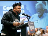 Phillip Agnew gestures as he speaks as a surrogate for Democratic Presidential Candidate Bernie Sanders Friday, Jan.24, 2020, in Iowa City, Iowa. (AP Photo/Sue Ogrocki)