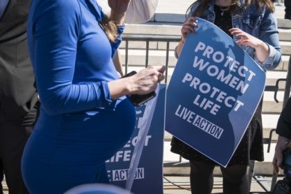 WASHINGTON, DC - MARCH 04: Pro-life activists participate in a rally outside of the Supreme Court as the justices hear oral arguments in the June Medical Services v. Russo case on March 4, 2020 in Washington, DC. The Louisiana abortion case is the first major abortion case to make it …
