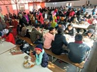 Bhutanese refugees lunch at a camp in Kathmandu before leaving for the United States on December 13, 2010. More than 100,000 refugees of Nepalese origin who left Bhutan after ethnic tensions in the early 1990s, have been living in exile in United Nations refugee camps in southern Nepal. US and …