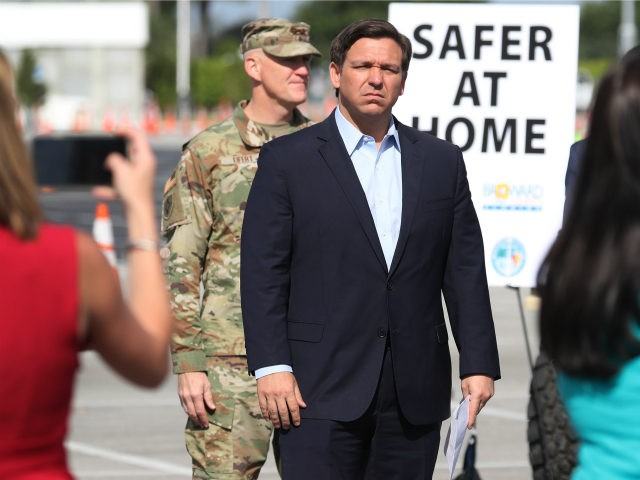 Florida Gov. Ron DeSantis attends a news conference in the Hard Rock Stadium parking lot on March 30, 2020 in Miami Gardens, Florida. The news conference, held at a COVID-19 testing center with the mayors from Miami-Dade, Broward, Palm Beach and Monroe counties, was used to explain efforts being taken …