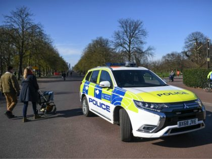 LONDON, ENGLAND - MARCH 22: A Police car is seen parked at the gates to Greenwich Park on March 22, 2020 in London, United Kingdom. British Prime Minister Boris Johnson urged that people don't visit their parents this Mothering Sunday to curb the spread of COVID-19, which has killed 233 …