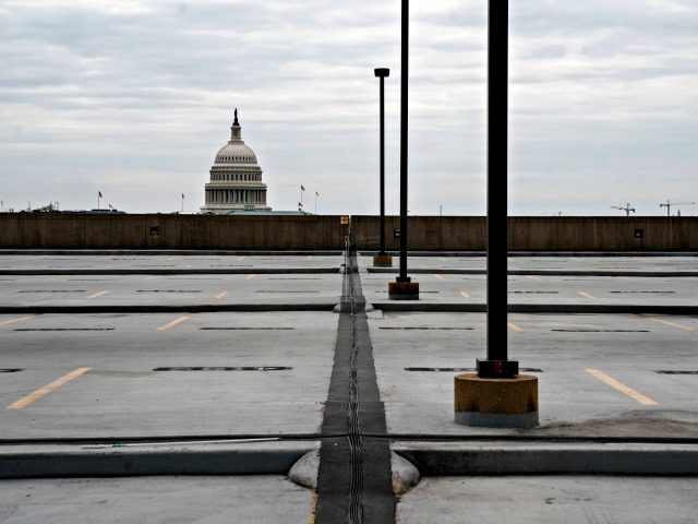 WASHINGTON, DC - MARCH 18: The top level of the parking garage at Union Station near the U.S. Capitol sits empty on March 18, 2020 in Washington, DC. The U.S. Senate is expected to pass a multibillion-dollar emergency aid package this week to confront the economic impacts of the coronavirus, …