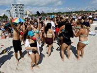 FILE - In this March 14, 2016, file photo, spring breakers gather in South Beach, at Miami Beach, Fla. College students relax and have fun during their spring break. Miami remains one of the most popular destinations for spring break. (AP Photo/Alan Diaz, File)