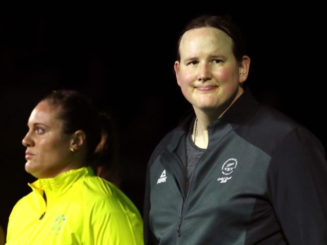 FILE - In this Monday, April 9, 2018 file photo, New Zealand's Laurel Hubbard, right, stands with Australia's Deb Lovely-Acason ahead of the women's +90kg weightlifting final at the 2018 Commonwealth Games on the Gold Coast, Australia. Hubbard was warmly welcomed by many spectators during the games, and was the …