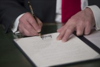 WASHINGTON, DC - JANUARY 20: President Donald Trump formally signs his cabinet nominations into law, in the PresidentÕs Room of the Senate, at the Capitol in Washington, January 20, 2017. (Photo by J. Scott Applewhite - Pool/Getty Images)