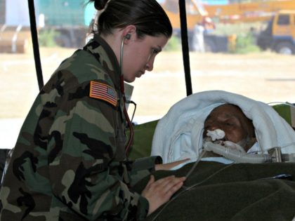 U.S. Army SPC Heather Marie Anellano Esplana, 212th MASH, Mobile Army Surgical Hospital, from Killeen, TX, 20, checks a Kashmiri earthquake survivor, over 80 and in severe condition at the US army field hospital in the devastated city of Muzaffarabad, Pakistan, Thursday, Oct. 27, 2005. US army has set up …