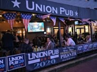"Patrons of the Union Pub wait for the results of the ""Super Tuesday"" Democratic Party primaries on Capitol Hill next to the US Congress in Washington on March 3, 2020. - Eyes glued to the continuous news coverage, the customers of this Washington bar close to the Capitol, parliamentary assistants, …"