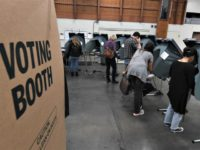 People vote at an Orange County polling station inside a fire station during the midterm elections in Huntington Beach, California, on November 6, 2018.Mark Ralston / AFP - Getty Images
