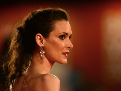"""US actress Winona Ryder arrives for the screening of """"The Iceman"""" at the 69th Venice Film Festival on August 30, 2012 at Venice Lido. """"The Iceman"""" is presented out of competition. AFP PHOTO / GABRIEL BOUYS (Photo credit should read GABRIEL BOUYS/AFP/GettyImages)"""