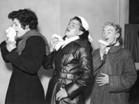 Three volunteers are infected with the common cold virus for research purposes at the Harvard Hospital in Wiltshire, 28th December 1955. From left to right, they are student Brenda Jeanes, German tourist Anne Weddig and civil servant Pat Brown. (Photo by FPG/Hulton Archive/Getty Images)