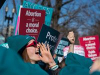 WASHINGTON, DC - MARCH 04: A person shouts slogans in an abortion rights rally outside of the Supreme Court as the justices hear oral arguments in the June Medical Services v. Russo case on March 4, 2020 in Washington, DC. The Louisiana abortion case is the first major abortion case …