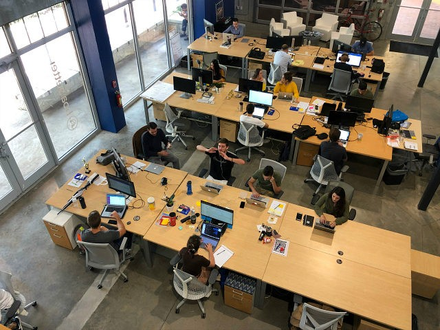 Staff at work in the Boatsetter office, a South Florida based boat-renting tech company on August 7, 2019 in Fort Lauderdale, Florida. - Strategically positioned, South Florida is a growing hub for startups and tech companies where unicorns are called, at least by one of the accelator companies in the …