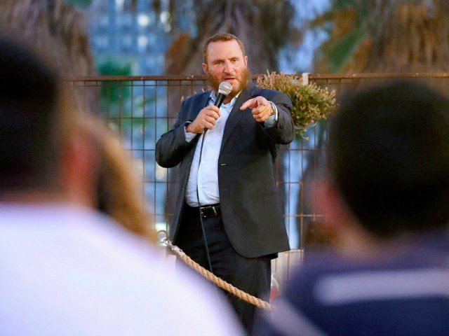 """Rabbi Shmuley Boteach, father of Chana Boteach, who runs a kosher sex shop in the Israeli coastal city of Tel Aviv, speaks during a conference on """"kosher sex"""" on August 29, 2019. - Behind what seems to be a nice clothing shop, the Rabbi's daughter sells sex toys and books …"""