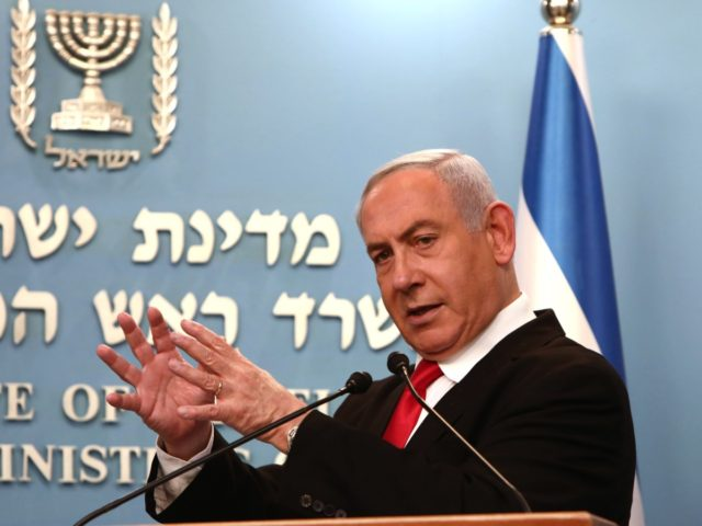Israeli Prime Minister Benjamin Netanyahu delivers an speech at his Jerusalem office on March 14, 2020, regarding the new measures that will be taken to fight the Corona virus in Israel. - Netanyahu said Israel would shut down eateries, shopping centres and gyms in a bid to halt the spread …
