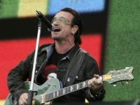 """LONDON - JULY 02: Singer Bono from the band U2 performs on stage at """"Live 8 London"""" in Hyde Park on July 2, 2005 in London, England. The free concert is one of ten simultaneous international gigs including Philadelphia, Berlin, Rome, Paris, Barrie, Tokyo, Cornwall, Moscow and Johannesburg. The concerts …"""