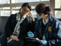 Centers for Disease Control and Prevention (CDC), Quarantine Station staff, respond to reports of sick travelers at 18 United States international airports, and land ports of entry, where most international travelers arrive. Here, CDC Quarantine, Public Health Officer, Diana Lu, was assessing a sick traveler, who had just arrived at …