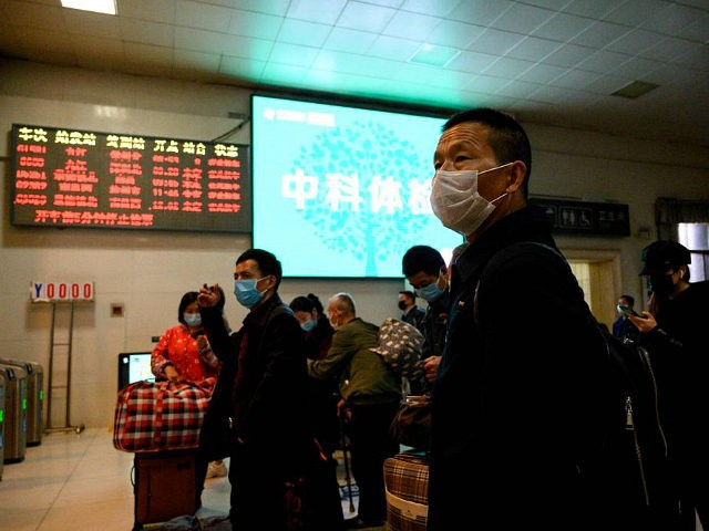 Passengers wearing face masks wait for a train to arrive at Jiujiang railway station in Jiujiang, a city which sits on the border between Chinas central Jiangxi province and Hubei province, the epicentre of the country's COVID-19 coronavirus outbreak, on March 18, 2020. (Photo by NOEL CELIS / AFP) (Photo …