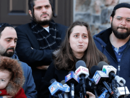In this Jan. 2, 2020, file photo, surrounded primarily by family, Nicky Kohen, the daughter of Josef Neumann who was critically injured in an attack on a Hanukkah celebration, speaks to reporters in front of her home in New City, N.Y. An Orthodox Jewish organization said Neumann died Sunday, March …