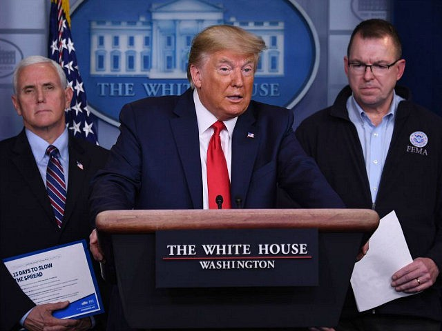 US President Donald Trump, flanked by FEMA Administrator Peter Gaynor (R) and US Vice President Mike Pence, speaks during the daily briefing on the novel coronavirus, COVID-19, at the White House on March 22, 2020, in Washington, DC. (Photo by Eric BARADAT / AFP) (Photo by ERIC BARADAT/AFP via Getty …