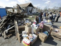 Household supplies are set up at a distribution center next to damaged homes Friday, March 6, 2020, in Nashville, Tenn. Residents and businesses face a huge cleanup effort after tornadoes hit the state Tuesday. (AP Photo/Mark Humphrey)