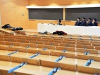 Examiners sit in an empty classroom as they listen to students defending their thesis on line, at the Politecnico University in Milan, Italy, Thursday, March 5, 2020. Italy's virus outbreak has been concentrated in the northern region of Lombardy, but fears over how the virus is spreading inside and outside …