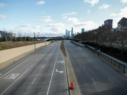Columbus Drive is seen empty in downtown Chicago, Illinois, on March 21, 2020. - Almost one billion people were confined to their homes worldwide Saturday as the global coronavirus death toll topped 12,000 and US states rolled out stay-at-home measures already imposed across swathes of Europe. More than a third …