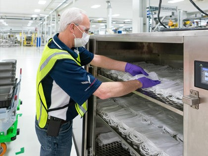 Engineers and technicians set-up and test the machines that will be used to manufacture Level 1 face masks Monday, March 30, 2020 at the General Motors Warren, Michigan manufacturing facility. Production will begin next week and within two weeks ramp up to 50,000 masks per day, with the potential to …