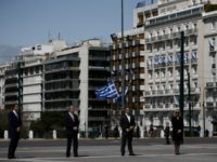 Greek Prime Minister Kyriakos Mitsotakis (L) and Greek former Prime Minister and leader of the main opposition Syriza party Alexis Tsipras (3rd L) with leaders of other parties attend a ceremony marking Greece's Independence Day, at the Tomb of the Unknown Soldier at central Syntagma Square in Athens, on 25 …