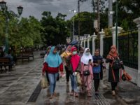 YOGYAKARTA, INDONESIA - MARCH 03: Indonesian women wear protective masks walk on the streets as Indonesia reports two cases of COVID-19 on March 3, 2020 in Yogyakarta, Indonesia. Two women in Indonesia have tested positive for Coronavirus and are being treated at Sulianti Saroso infectious diseases hospital in Jakarta. The …