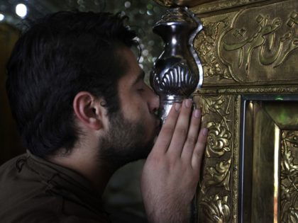 Watch – Iranian Muslims Lick, Kiss Shrines: Say They Are 'Not Scared of Coronavirus'