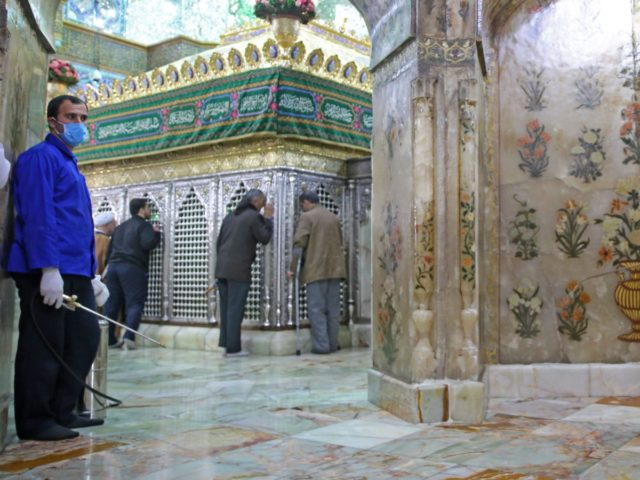 Iranian sanitary workers disinfect Qom's Masumeh shrine on February 25, 2020 to prevent the spread of the coronavirus which reached Iran, where there were concerns the situation might be worse than officially acknowledged. - The deaths from the disease -- officially known as COVID-19 -- in the Islamic republic were …