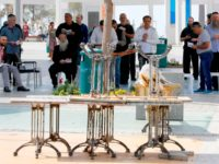 Israeli Jewish worshippers perform midday prayers in the Israeli coastal city of Netanya on March 15, 2020, after Israel shut down eateries, shopping centres and gyms in a bid to halt the spread of novel coronavirus. - The new instructions also prohibit gatherings of over 10 people and advise people …