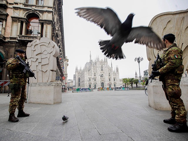 Italian soldiers patrol as the Duomo gothic cathedral is visible in background, in Milan, Friday, March 20, 2020. Mayors of many towns in Italy are asking for ever more stringent measures on citizens' movements to help contain the surging infections of the coronavirus. For most people, the new coronavirus causes …