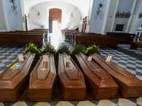 This picture taken on March 21, 2020 shows coffins on the ground of the church in Serina, near Bergamo, northern Italy. - Italy on March 21 reported 793 new coronavirus deaths, a one-day record that saw the country's toll shoot up to 4,825, the 38.3 percent of the world's totality. …