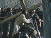 "Actor Jim Caviezel portrays Jesus carrying the Cross in a scene from the new film ""The Passion of The Christ"" in this undated publicity photograph. The film, produced and directed by actor Mel Gibson, is a vivid depiction of the last twelve hours of the life of Jesus Christ. The …"